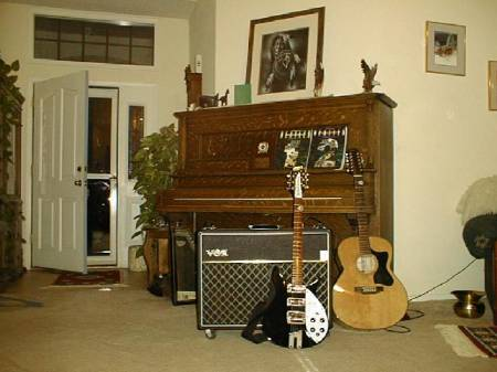 My_John_Lennon_Rickenbacker_w/_VOX_AC-30,_my_12_String_Pimmentel_and_Hamilton_Upright_Grand.jpg